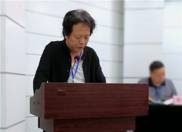 程良曜代表第五届主席团作工作报告.jpg